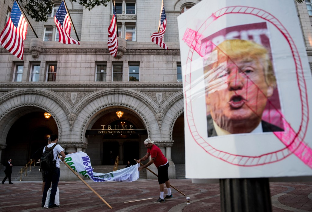 The ANSWER Coalition prepares to hold a protest in front of the Trump International Hotel on Pennsylvania Avenue in Washington on Monday, Sept. 12, 2016 as the hotel prepares to open to the public later in the day. (Bill Clark/CQ Roll Call)