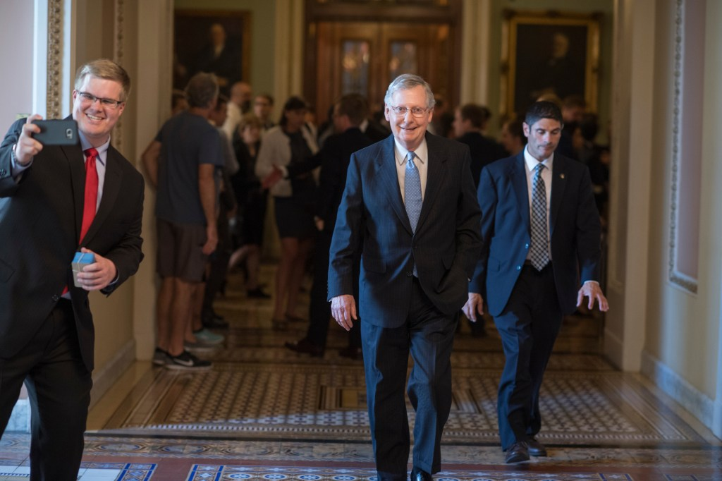 A man tries to take a picture with Senate Majority Leader Mitch McConnell in the Capitol on Tuesday, Sept. 13, 2016. (Tom Williams/CQ Roll Call)