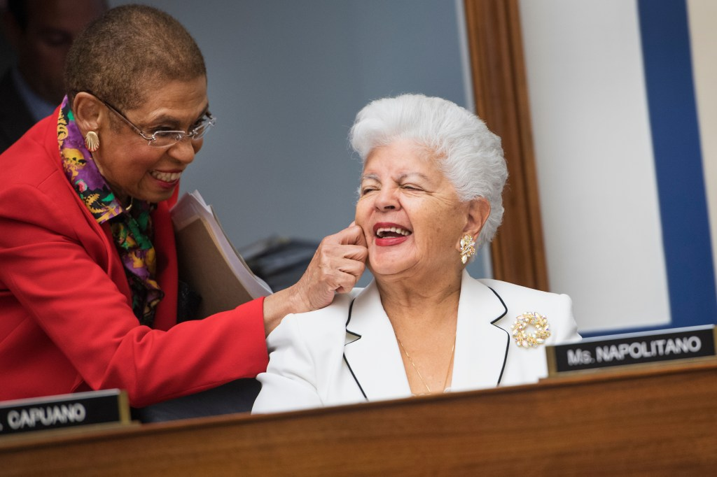 D.C. Del. Eleanor Holmes Norton pinches the cheek of California Rep. Grace Napolitano during a House Transportation and Infrastructure Committee markup in the Rayburn Building on Wednesday, Sept. 14, 2016. (Tom Williams/CQ Roll Call)