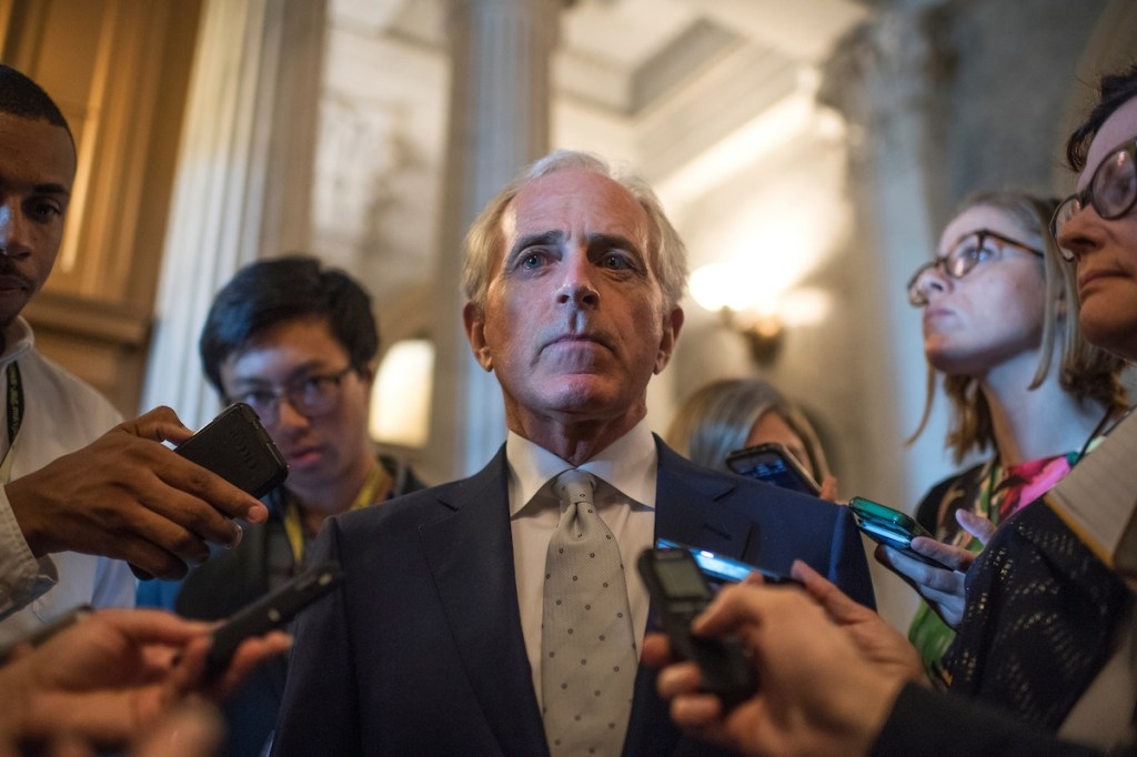Tennessee Sen. Bob Corker, center, speaks with reporters after the Senate Policy luncheons in the Capitol on Tuesday, Sept. 20. (Tom Williams/CQ Roll Call)