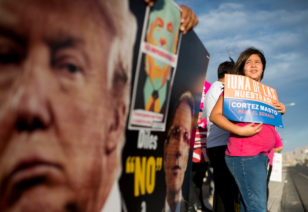 Oct. 14, 2016: Supporters of Catherine Cortez Masto, Democratic candidate for Senate from Nevada, line the sidewalk outside of the Canyon Springs High School in North Las Vegas before the start of the of the debate between Cortez Masto and Rep. <a class=