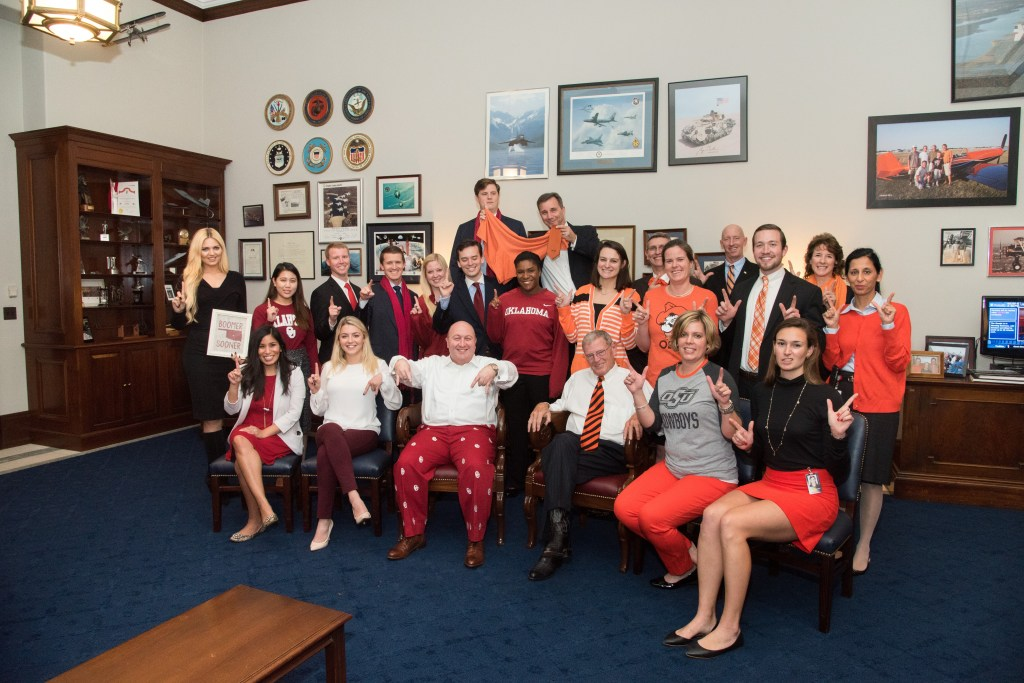 Sen. Jim Inhofe, center bottom, and his staff show off their Oklahoma gear. (Photo courtesy of Inhofe's office)