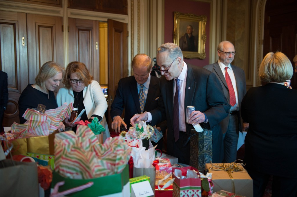 From left to right: Sen. Kristin Gilibrand, D-N.Y., Sen. Heidi Heitkamp, D-N.D., Sen. Bill Nelson, D-Fla., and Sen. Charles E. Schumer, D-N.Y., at the holiday gift exchange. (Photo courtesy of Franken's office.)