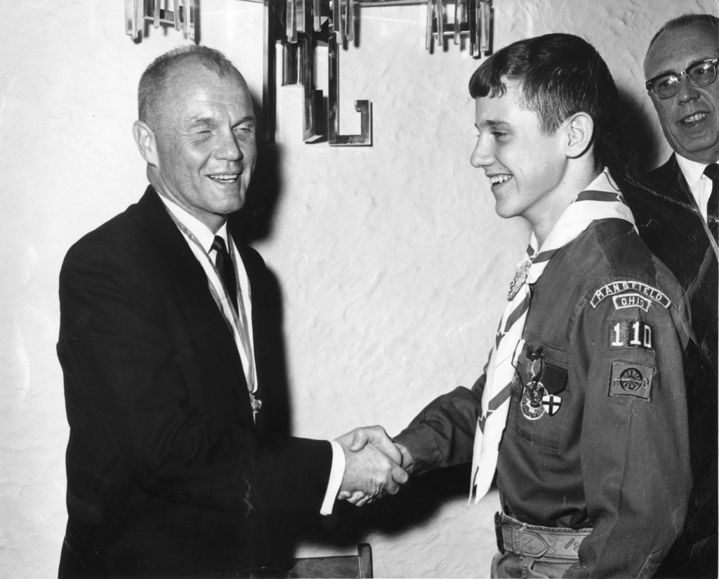 Future senator meets future senator: Glenn shakes hands with Mansfield High School student Sherrod Brown in 1967 after Brown received his Eagle Scout award. (CQ Roll Call file photo)