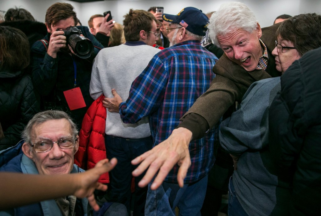 3. Jan. 15: Former President Bill Clinton reaches for a young boy's hand after a campaign event as he helps promote his wife, Democratic presidential candidate <a class=