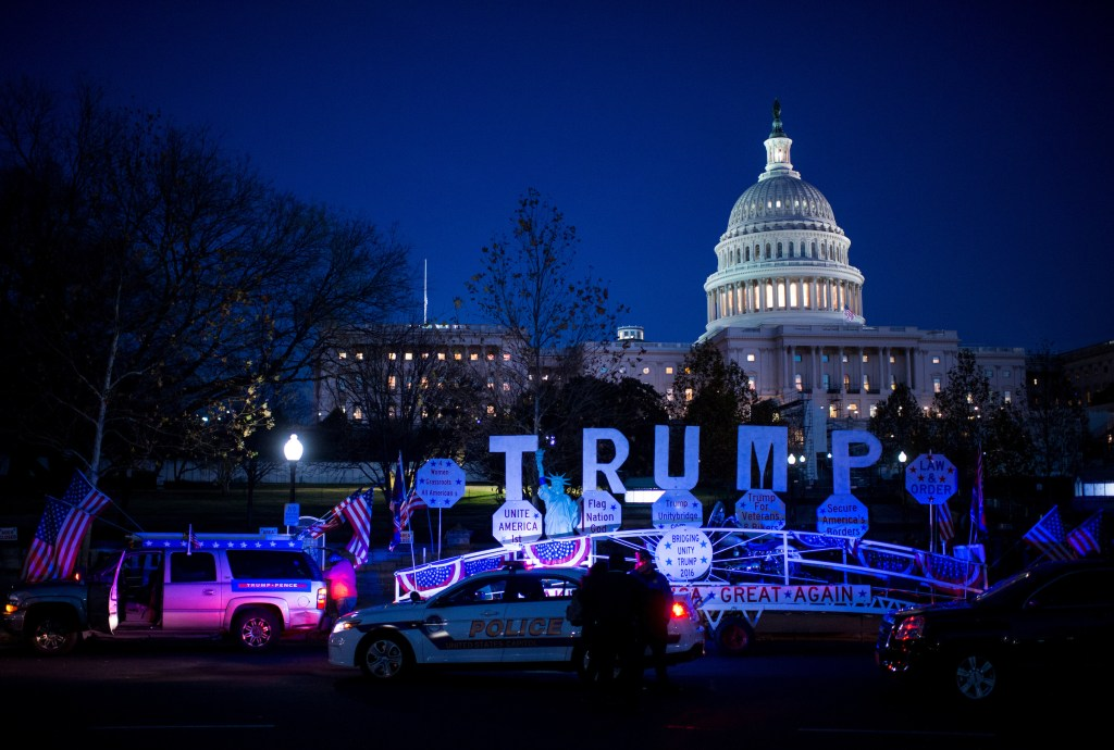 U.S. Capitol Police investigate an unidentified man pulling a Trump-decorated trailer parked on the west side of the U.S. Capitol on Wednesday, Dec. 7, 2016. (Bill Clark/CQ Roll Call)