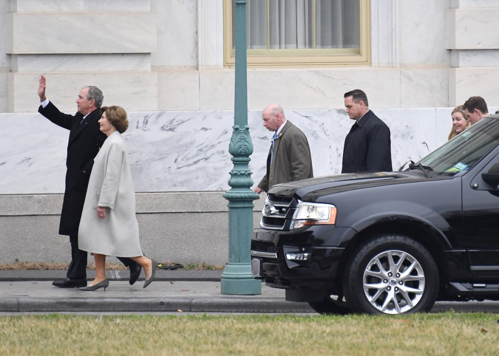 Former President George W. Bush and Laura Bush arrive for the inauguration. (Bill Clark/ CQ Roll Call)