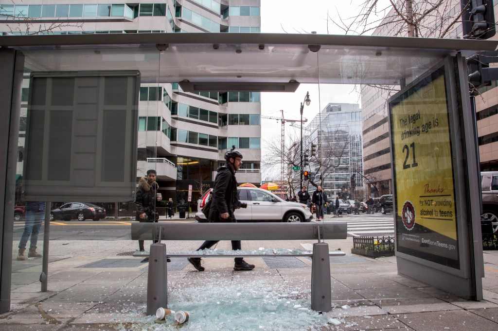 A shattered bus stop booth on 14th street in downtown Washington on Friday. (Matt Rhodes for CQ Roll Call)