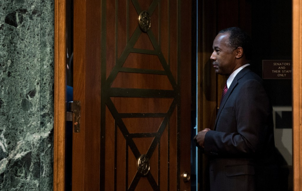 Trump's nominee to lead the Housing and Urban Development Department, Ben Carson, enters the Senate Banking, Housing and Urban Affairs Committee offices before his confirmation hearing on Thursday. (Bill Clark/CQ Roll Call)