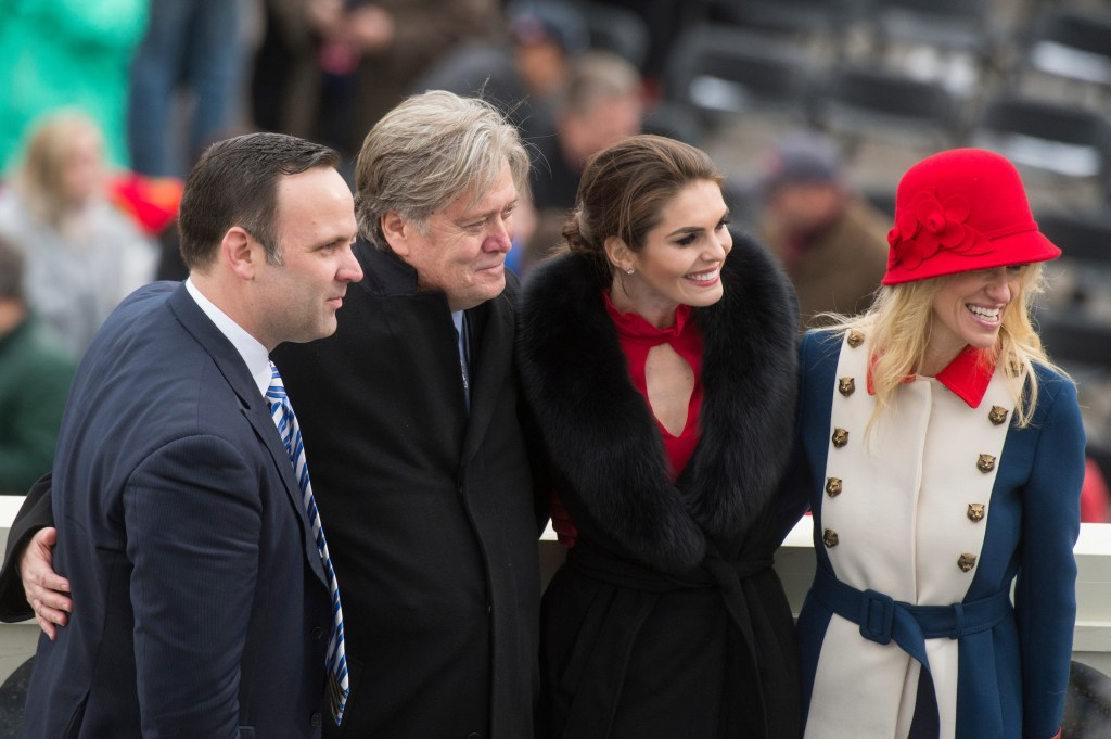 UNITED STATES - JANUARY 20: From left, Dan Scavino, Stephen Bannon, Hope Hicks, and Kellyanne Conway, aides to President Donald J. Trump, pose for a picture on the West Front of the Capitol after Trump was sworn in as the 45th President of the United States, January 20, 2017. (Photo By Tom Williams/CQ Roll Call)