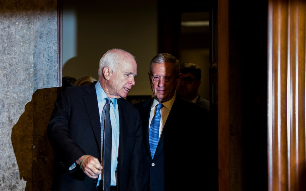 Chairman Sen. John McCain, R-Ariz., escorts Secretary of Defense nominee James Mattis to the hearing room for his confirmation hearing in the Senate Armed Services Committee on Thursday. (Bill Clark/CQ Roll Call)