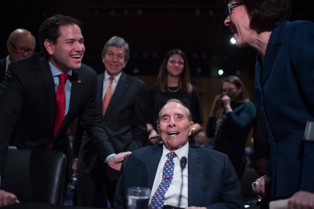 Former Sen. Bob Dole, R-Kan., talks with Sens. Marco Rubio, R-Fla., and Susan Collins, R-Maine, during a recess in the confirmation hearing for Rep. Mike Pompeo, R-Kan., nominee for director of the Central Intelligence Agency on Thursday. (Tom Williams/CQ Roll Call)
