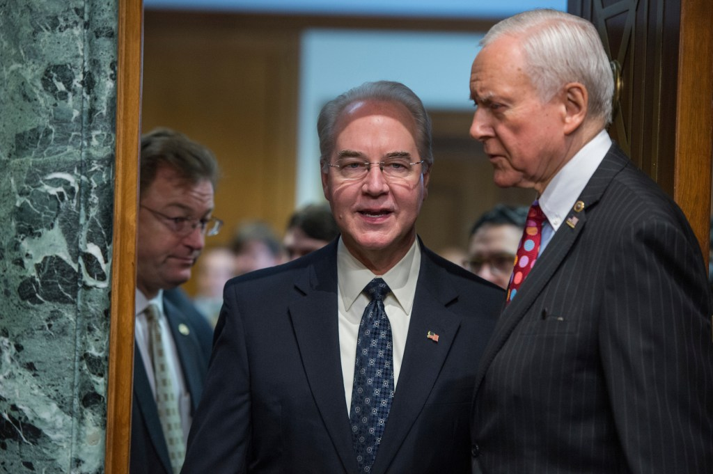 UNITED STATES - JANUARY 24: Rep. Tom Price, R-Ga., center, nominee for Health and Human Services secretary, is seen with Chairman Orrin Hatch, R-Utah, before his Senate Finance Committee confirmation hearing in Dirksen Building, January 24, 2017. (Photo By Tom Williams/CQ Roll Call)