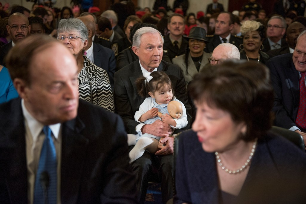 UNITED STATES - JANUARY 10: Sen. Jeff Sessions, R-Ala., President-elect Trump's nominee for attorney general, holds one of his granddaughters before his Senate Judiciary Committee confirmation hearing in Russell Building's Kennedy Caucus Room, January 10, 2017. Sens. Richard Shelby, R-Ala., left, and Susan Collins, R-Me., prepare to introduce him. (Photo By Tom Williams/CQ Roll Call)