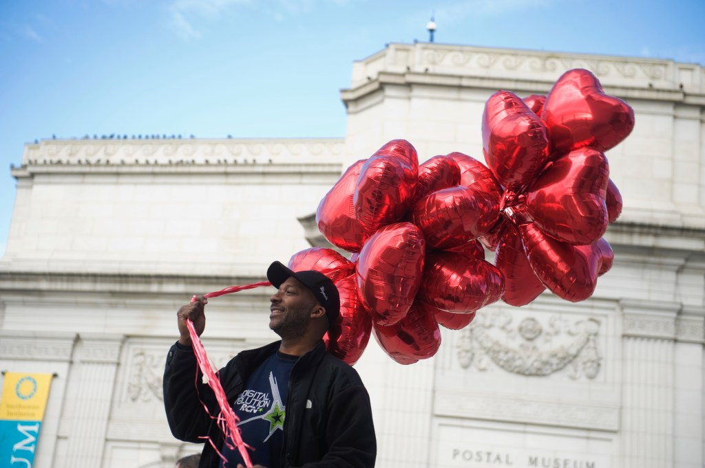 UNITED STATES - FEBRUARY 14: Rick McCollum sells heart shaped balloons for Valentine's Day outside of Union Station. (Photo By Tom Williams/Roll Call)
