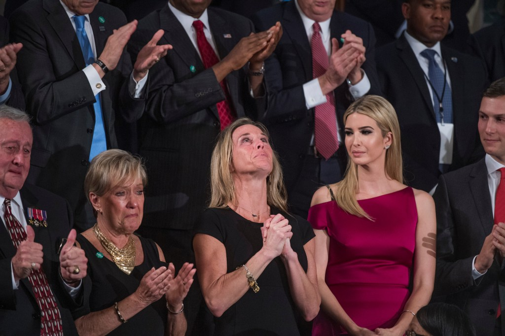 """Carryn Owens, widow of Navy SEAL William """"Ryan"""" Owens, reacts after being recognized by President Donald Trump. Owens was killed in January during a raid in Yemen. (Tom Williams/CQ Roll Call)"""