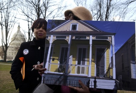 Linda Nelson hold a picture of her house in New Orleans that was destroyed after hurricane Katrina, at a rally with survivors of the storm, in Upper Senate Park.  The rally was held by ACORN Katrina Survivors Association and democratic senators to bring attention the still looming problem that evacuees face and that they need government help to get back on their feet.  Blanche Barnes, left, also lost her home.