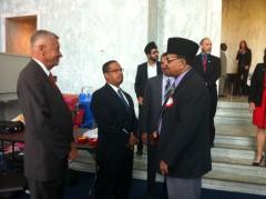 Petri (left) and Ellison (center) talk with Naseem Mahdi, an Ahmadiyya Muslim Communtiy national vice president. (Bridget Bowman/CQ Roll Call)