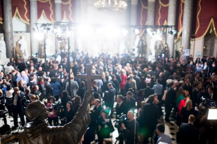 The statue of Junipero Serra overlooks members of the press and members of Congress in Statuary Hall following President Barack Obama's State of the Union address in the Capitol on Tuesday, Jan. 20, 2015. (Photo By Bill Clark/CQ Roll Call File Photo)