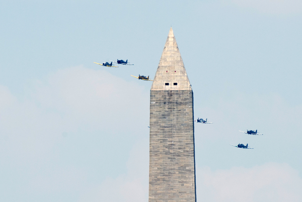 World War II era planes fly past the Washington Monument. (Bill Clark/CQ Roll Call)