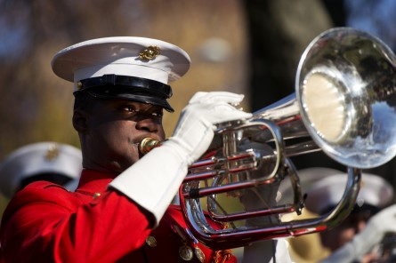 UNITED STATES - NOVEMBER 11: A member of the U.S. Marine Drum & Bugle Corps plays during at a Veteran's Day ceremony in Folger Park on Capitol Hill hosted by the American Legion Post 8, November 11, 2014. (Photo By Tom Williams/CQ Roll Call)