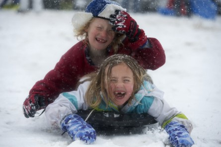 UNITED STATES - MARCH 05: Catie Guire and Will Weedon, both 8, of Capitol Hill, sled on the west front lawn of the Capitol during a snow storm, March 5, 2015. (Photo By Tom Williams/CQ Roll Call)