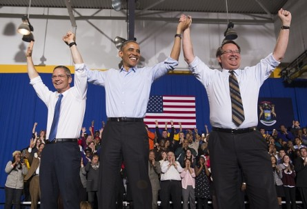 Obama campaigned in Michigan in 2014 for Mark Schauer, left, who ran for governor, and Gary Peters, right, who won his Senate race. (Saul Loeb, AFP/Getty Images)