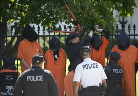 Police use bolt cutters to cut the chains used by protesters to chain themselves to the White House fence during a protest against the war in Afghanistan and torture in 2009. (CQ Roll Call File Photo)