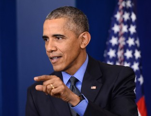 US President Barack Obama gestures during a press conference in the briefing room of the White House in Washington, DC on December 18, 2015. Obama addressed the press before flying to San Bernardino to meet families of the victims of the December 2 attack, before continuing to Hawaii for a two-week family vacation. AFP PHOTO/ ANDREW CABALLERO-REYNOLDS / AFP / Andrew Caballero-Reynolds        (Photo credit should read ANDREW CABALLERO-REYNOLDS/AFP/Getty Images)