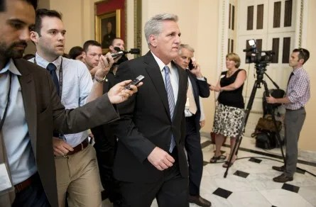 House Majority Whip Kevin McCarthy, R-Calif., makes his way to the House floor through the media pack, who were waiting for House Majority Leader Eric Cantor on Wednesday, June 11, 2014. (Photo By Bill Clark/CQ Roll Call)