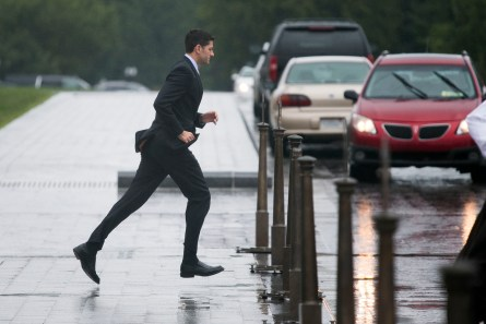 UNITED STATES - October 1: Rep. Paul Ryan, R-Wi., runs through the rain to his car after final votes in the House of Representatives outside of the U.S. Capitol in Washington, on Thursday, Oct. 1, 2015. (Photo By Al Drago/CQ Roll Call)