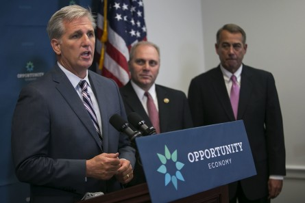 McCarthy, R-Calif., speaks beside House Majority Whip Steve Scalise, R-La., center, and outgoing Speaker of the House John Boehner, R-Ohio, right, during a news conference on Capitol Hill in Washington, Tuesday, Sept. 29, 2015. McCarthy is reinforcing to Republicans that he can keep them united, despite conservatives trying to move their party to the right after Boehner's sudden resignation. (Photo By Al Drago/CQ Roll Call)