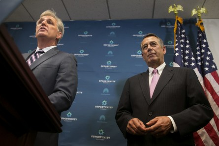 Boehner, R-Ohio, and House Majority Leader Kevin McCarthy, R-Calif., listen during a news conference on Capitol Hill in Washington, Tuesday, Sept. 29, 2015. McCarthy is reinforcing to Republicans that he can keep them united, despite conservatives trying to move their party to the right after Boehner's sudden resignation. (Photo By Al Drago/CQ Roll Call) Copyright © 2015 CQ-Roll Call, Inc.