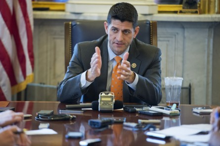 Ryan conducts a pen and pad briefing with reporters. (Tom Williams/CQ Roll Call file photo)