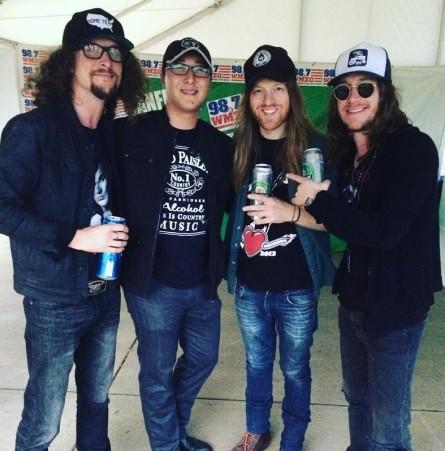 Members of The Cadillac Three huddle around one-time Issa spox Kurt Bardella at Jiffy Lube Live. (Courtesy Kurt Bardella)