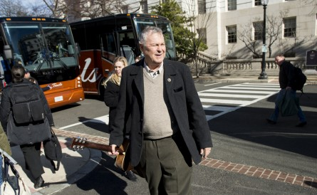 UNITED STATES - JANUARY 13: Rep. Dana Rohrabacher, R-Calif., carries a guitar to the buses outside of the Rayburn House Office Building bound for the Joint Republican Issues Conference in Baltimore on Wednesday, Jan. 13, 2016. (Photo By Bill Clark/CQ Roll Call)