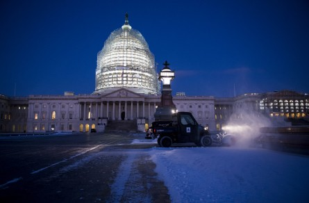 Architect of the Capitol crews clear snow from the East Plaza of the Capitol at sunrise on Thursday, Jan. 21, 2016, after a storm left about an inch of snow in the Washington area overnight. The DC area is bracing for blizzard conditions over the weekend. (Bill Clark/CQ Roll Call)