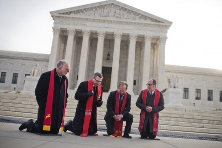 UNITED STATES - FEBRUARY 19: Reverends for the National Clergy Council, from left, Kenneth Church, Rob Schenck, Allen Church, and Patrick Mahoney, pray in front of the Supreme Court before the body of Justice Antonin Scalia arrived to lie in repose, February 19, 2016, ahead of his burial tomorrow. (Photo By Tom Williams/CQ Roll Call)