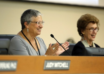 Mary Nichols, left, chairwoman of the California Air Resources Board, applauds after the board restored ambitious rules to cut transportation fuel emissions 10 percent within 5 years, during a hearing in Sacramento, Calif., Friday, Sept. 25, 2015. By a 9-0 vote the board restored rules requiring a 10 percent cut in carbon emissions on fuels sold in the state by 2020, despite oil industry objections that it could drive up gas prices. At right is ARB board member Barbara Riordan. (AP Photo/Rich Pedroncelli)