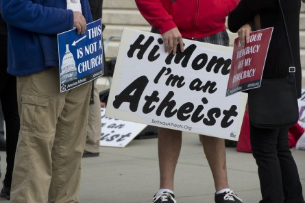 Protesters gather outside the Supreme Court during arguments over prayer at public meetings and the separation of church and state in November 2013. (CQ Roll Call File Photo)