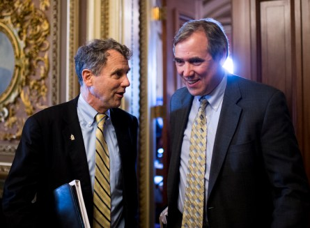 Brown, left, and Merkley joined with all but one Democrat to block fast track trade legislation from moving forward. (Bill Clark/CQ Roll Call)