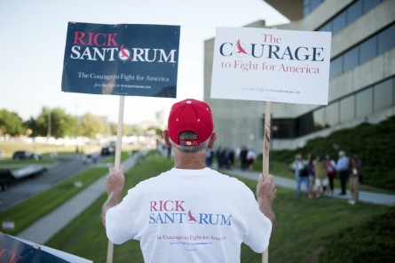 A Santorum fan in Iowa awaits the August 2011 presidential debate. The former senator could be excluded from this year's debates. (Tom Williams/CQ Roll Call File Photo)