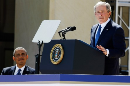 DALLAS, TX - APRIL 25:  U.S. President Barack Obama (L) listens as former President George W. Bush speaks during the opening ceremony of the George W. Bush Presidential Center April 25, 2013 in Dallas, Texas. The Bush library, which is located on the campus of Southern Methodist University, with more than 70 million pages of paper records, 43,000 artifacts, 200 million emails and four million digital photographs, will be opened to the public on May 1, 2013. The library is the 13th presidential library in the National Archives and Records Administration system.  (Photo by Tony Gutierrez-Pool/Getty Images)
