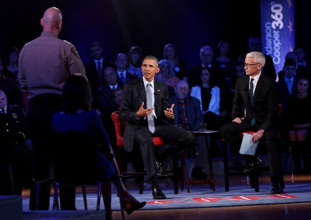 FAIRFAX, VA - JANUARY 7:  (AFP OUT) U.S. President Barack Obama listens to a question from Arizona Sheriff Paul Babeu during  a live town hall event with CNN's Anderson Cooper  (R) at town hall at George Mason University on January 7, 2016 in Fairfax, Virginia. The president this week announced new, relatively mild executive actions to regulate the gun industry.  (Photo by Aude Guerrucci-Pool/Getty Images)