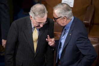 Reid and McConnell chat on the House floor before Afghan President Ashraf Ghani addressed a joint meeting of Congress on March 25. (Tom Williams/CQ Roll Call File Photo)