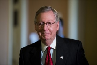 McConnell, R-Ky., walks to the Senate floor to lead the procession of Senators to the House floor for Israeli Prime Minister Benjamin Netanyahu's speech on Tuesday, March 3, 2015. (Photo By Bill Clark/CQ Roll Call)