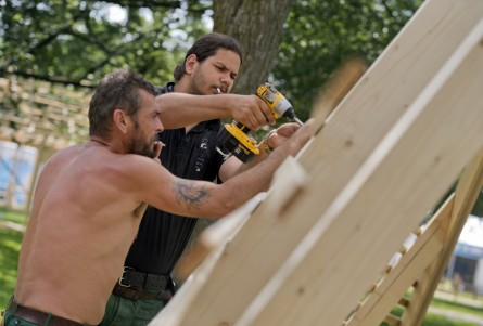 Hungarian craftsmen Palkovics Batázs, right, and Varga Istuán Jozsef, assemble a stage for the Hungary exhibit in the Smithsonian Folklife Festival. (Tom Williams/CQ Roll Call.)