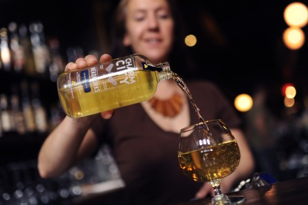 Mary Kate Wrzesniewski, general manager at Boundary Road on H Street NE, pours a honey wine made by Charm City Meadworks,