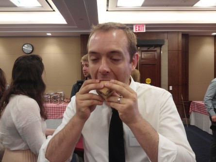 Congressional Vegetarian Staff Association founder Adam Sarvana sinks his teeth into some plant-based nosh at inaugural Veggie Burger Smackdown event in Rayburn. (Warren Rojas/CQ Roll Call)