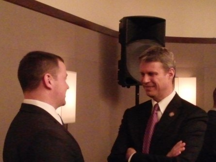 Rep. Bill Huizenga chats with a Wall Street Warfighters Foundation alumnus during a reception on Capitol Hill. (Warren Rojas/CQ Roll Call)